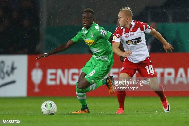 Kai Proeger of Essen challenges Denis Zakaria of Mnchengladbach during the DFB Cup first round match between RotWeiss Essen and Borussia...