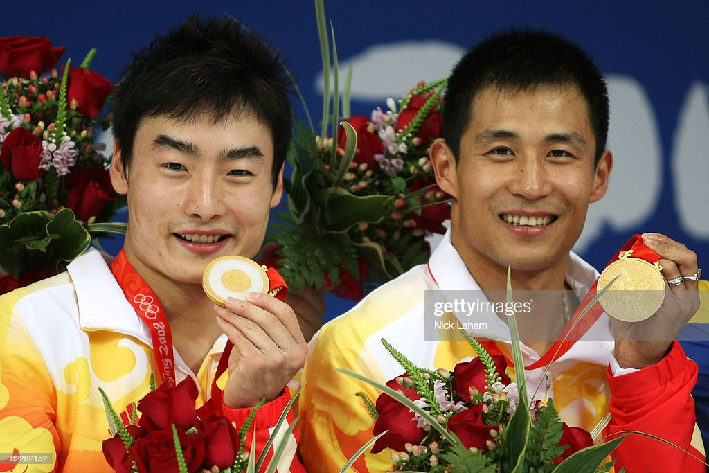 Kai Qin and Wang Feng of China pose with the gold medal during the medal ceremony for the Men's Synchronised 3m Springboard held at the National...