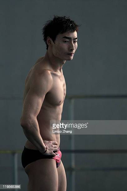 Kai Qin of China looks on as he competes in the Men's 3m Springboard Final during Day Seven of the 14th FINA World Championships at the Oriental...