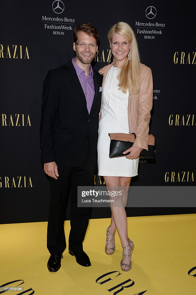 Kai Rose and Natascha Gruen attend the Mercedes-Benz Fashion Week Berlin Spring/Summer 2014 Preview Show by Grazia at the Brandenburg Gate on July 1, 2013 in Berlin, Germany.