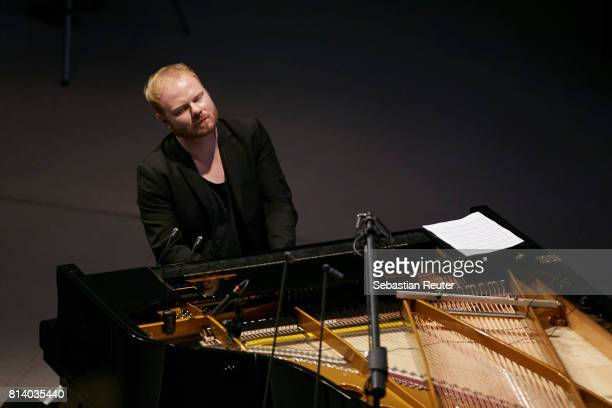 Kai Schumacher performs with the Kammerorchester Berlin at Volkswagen Group Forum DRIVE on July 13 2017 in Berlin Germany