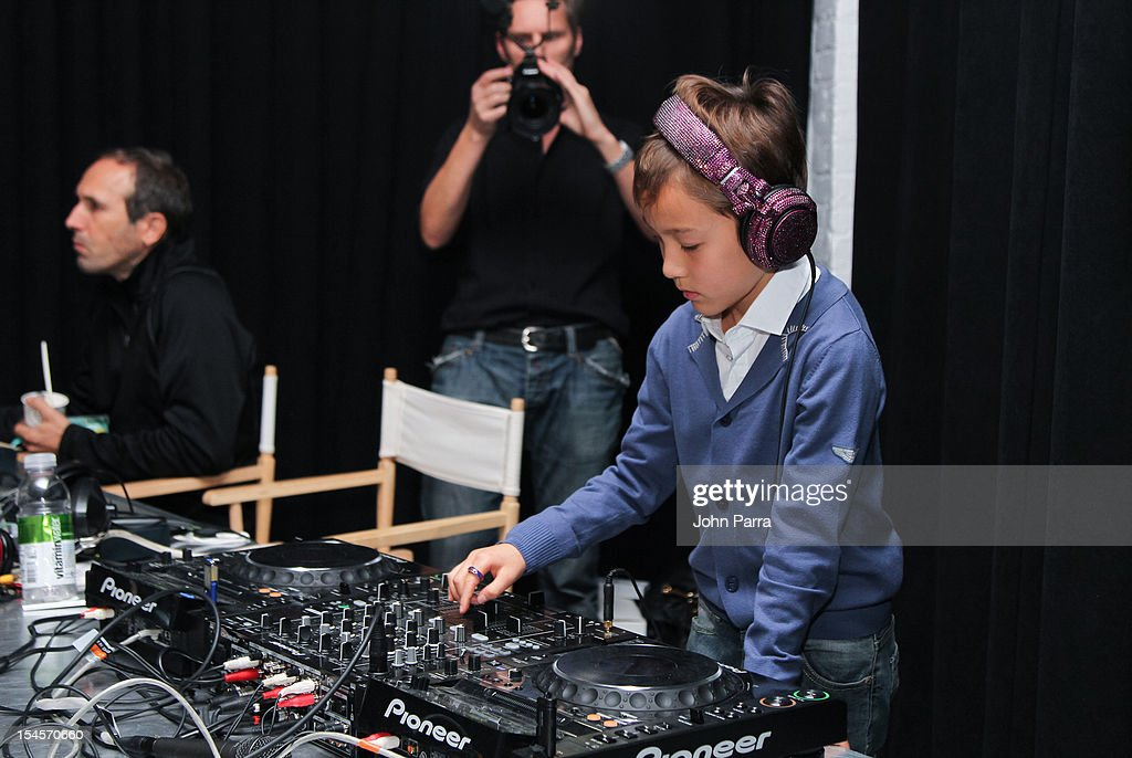 DJ Kai spins during the Swarovski Elements at Petite Parade NY Kids Fashion Week In Collaboration With VOGUEbambini - Day 2 at Industria Superstudio on October 21, 2012 in New York City.