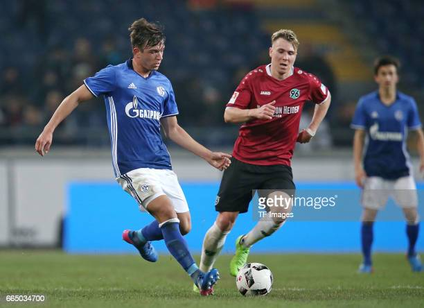 Kai Wagner of Schalke and Felix Klaus of Hannover battle for the ball during the friendly match between Hannover 96 an FC Schalke 04 at HDIArena on...