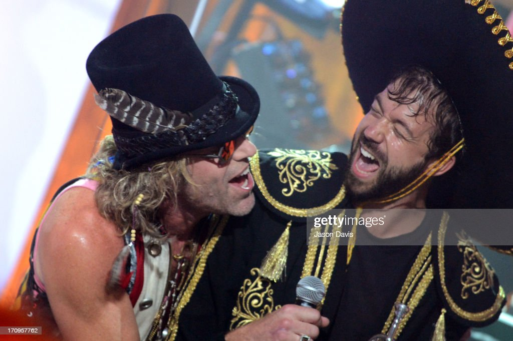 Kai Welch (R) and Big Kenny of Electro Shine perform during the MTV, VH1, CMT & LOGO 2013 O Music Awards on June 20, 2013 in Nashville, Tennessee.
