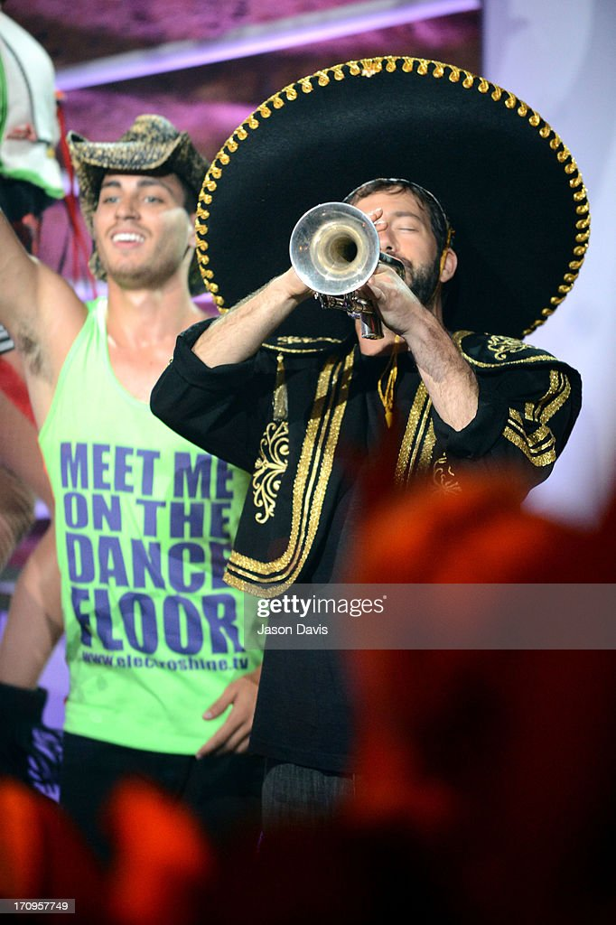 Kai Welch (R) of Electro Shine performs during the MTV, VH1, CMT & LOGO 2013 O Music Awards on June 20, 2013 in Nashville, Tennessee.