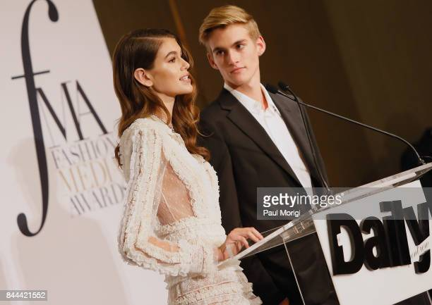 Kaia Gerber and Presley Gerber present an award onstage during the Daily Front Row's Fashion Media Awards at Four Seasons Hotel New York Downtown on...