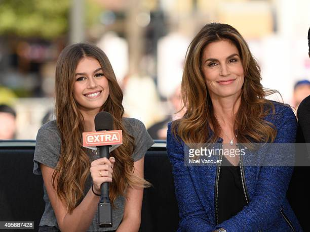 Kaia Jordan Gerber and Cindy Crawford visit 'Extra' at Universal Studios Hollywood on November 4 2015 in Universal City California
