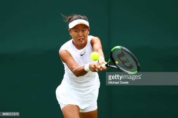 KaiChen Chang of Chinese Tapei plays a backhand during the Ladies Singles first round match against Qiang Wang of China on day one of the Wimbledon...