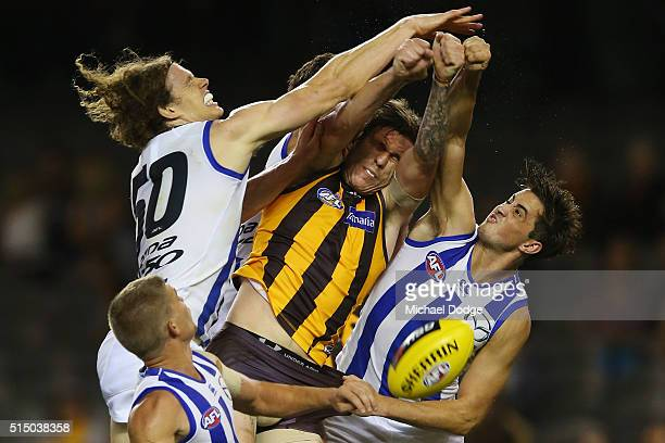 Kaiden Brand of the Hawks competes for the ball against Ben Brown and Taylor Garner of the Kangaroos during the NAB CHallenge AFL match between the...