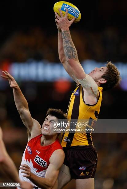 Kaiden Brand of the Hawks marks the ball over George Hewett of the Swans during the 2017 AFL round 19 match between the Hawthorn Hawks and the Sydney...