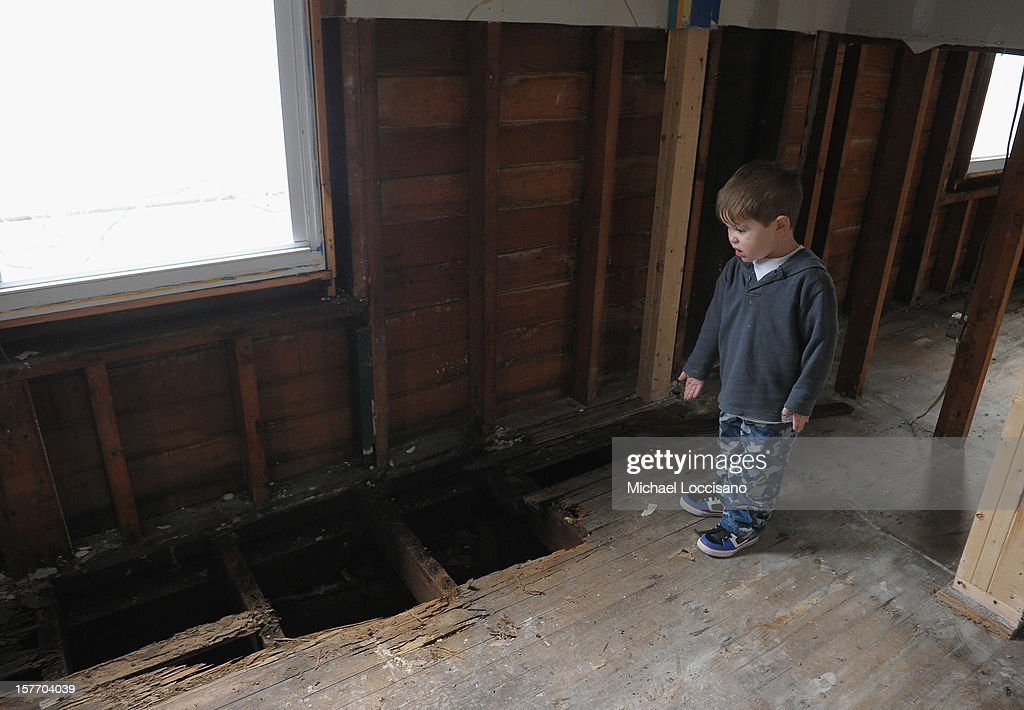 Kaiden Van Rikxoort visits his home devastated by Superstorm Sandy a month prior on December 5, 2012 in Union Beach, New Jersey. With a population of 6,200, roughly 1,000 homes were flooded and 200 rendered inhabitable.