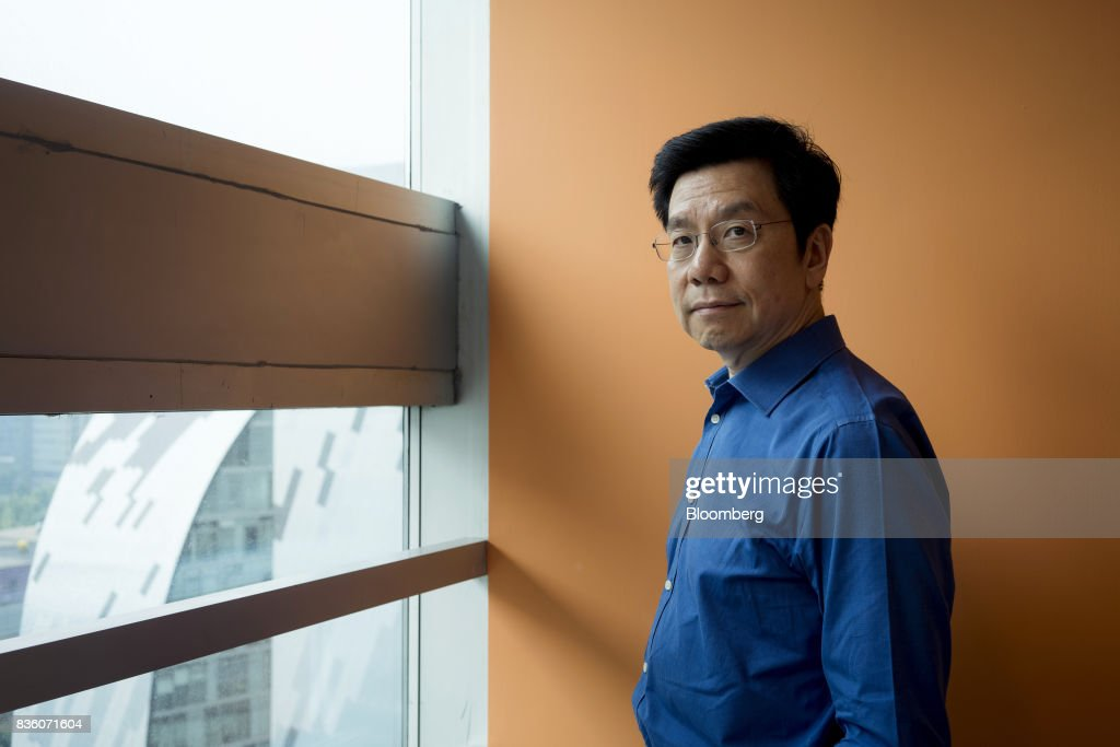 Kai-Fu Lee, founder of Sinovation Ventures, poses for a photograph in Beijing, China, on Tuesday, Aug. 15, 2017. Sinovation Ventures' latest growing endeavor, an in-house AI Institute, has about 30 full-time employees with plans to grow headcount to about a hundred within the year. Photographer: Giulia Marchi/Bloomberg via Getty Images