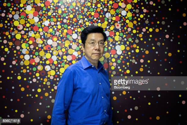 KaiFu Lee founder of Sinovation Ventures poses for a photograph in Beijing China on Tuesday Aug 15 2017 Sinovation Ventures' latest growing endeavor...