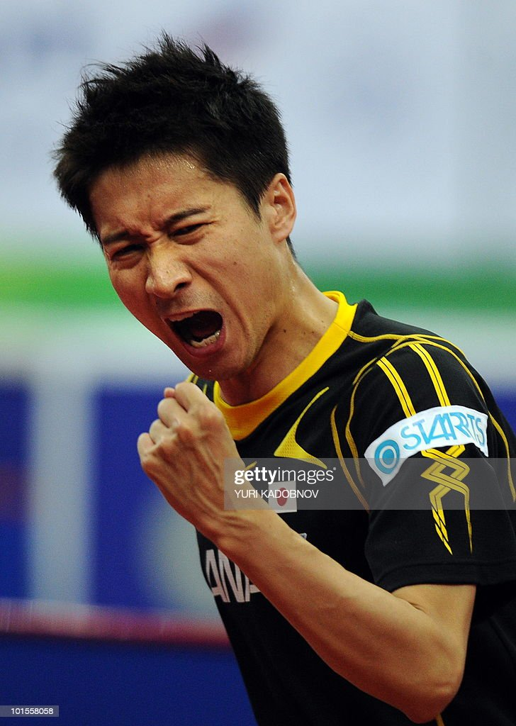 Kaii Yoshida of Japan reacts during his match against Carlos Machado of Spain at the men's team group C match at the 2010 World Team Table Tennis Championships in Moscow on May 26, 2010.
