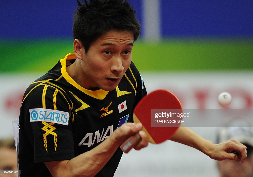 Kaii Yoshida of Japan returns a service to Morten Rasmussen of Denmark during their men's teams group C match at the 2010 World Team Table Tennis Championships in Moscow on May 25, 2010.