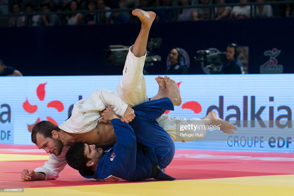 Kaila Martin Pacek (white) of Sweden fights with Tagir Khaibulaev (blue) of Russia during the men's -100kg fight as part of the World Judo Masters Guadalajara 2016 at Adolfo Lopez Mateos Sports Centre on May 28, 2016 in Gudalajara, Mexico.