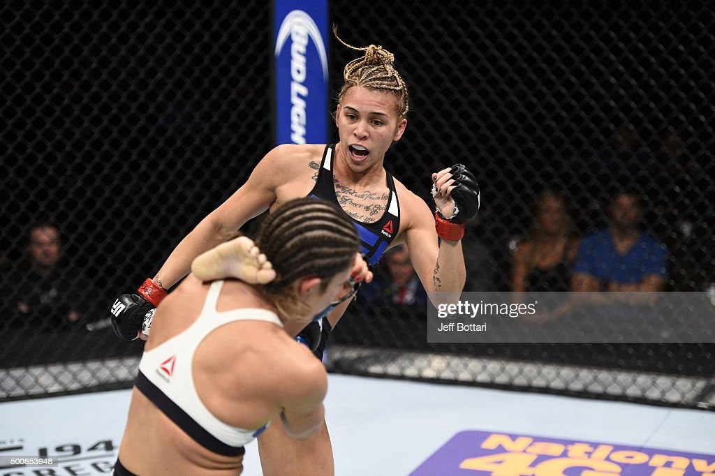 Kailan Curran kicks Emily Kagan in their women's strawweight bout during the UFC Fight Night event at The Chelsea at the Cosmopolitan of Las Vegas on December 10, 2015 in Las Vegas, Nevada.