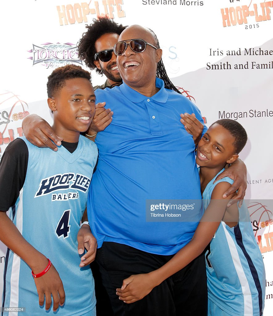Kailand Morris Kwame Morris and Mandla Morris lift their father Stevie Wonder on the red carpet at the 3rd annual HoopLife FriendRaiser at Galen...