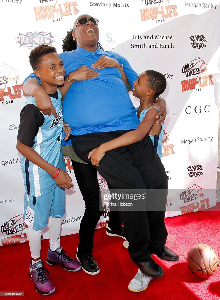 Kailand Morris, Kwame Morris and Mandla Morris lift their father, Stevie Wonder (C), on the red carpet at the 3rd annual Hoop-Life FriendRaiser at Galen Center on August 30, 2015 in Los Angeles, California.
