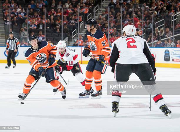 Kailer Yamamoto and Connor McDavid of the Edmonton Oilers battle against Derick Brassard and Dion Phaneuf of the Ottawa Senators on October 14 2017...