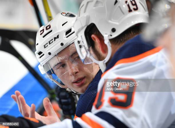 Kailer Yamamoto and Patrick Maroon of the Edmonton Oilers discuss the play during the preseason game against the Carolina Hurricanes on September 25...