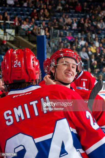 Kailer Yamamoto and Ty Smith of the Spokane Chiefs stand on the ice agaisnt the boards in front of the bench during a time out against the Kelowna...