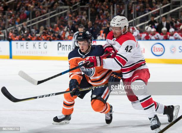 Kailer Yamamoto of the Edmonton Oilers battles against Joakim Nordstrom of the Carolina Hurricanes on October 17 2017 at Rogers Place in Edmonton...