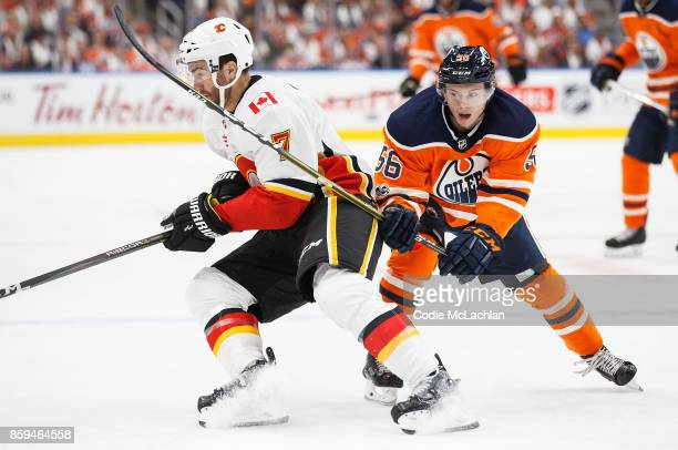 Kailer Yamamoto of the Edmonton Oilers battles against TJ Brodie of the Calgary Flames at Rogers Place on October 4 2017 in Edmonton Canada