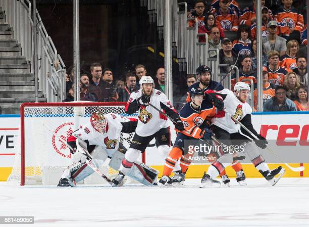 Kailer Yamamoto of the Edmonton Oilers battles in front of the net with Fredrik Claesson of the Ottawa Senators on October 14 2017 at Rogers Place in...