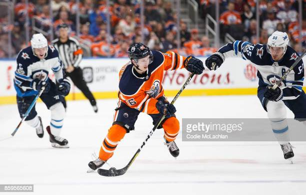Kailer Yamamoto of the Edmonton Oilers is trailed by Mark Scheifele of the Winnipeg Jets at Rogers Place on October 9 2017 in Edmonton Canada