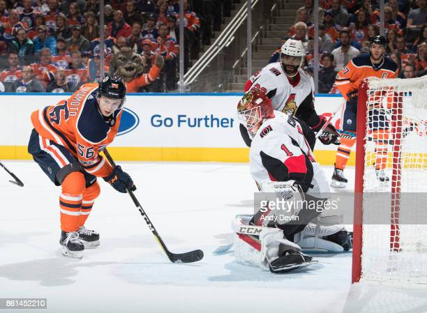 Kailer Yamamoto of the Edmonton Oilers looks for a shot on goaltender Mike Condon of the Ottawa Senators on October 14 2017 at Rogers Place in...