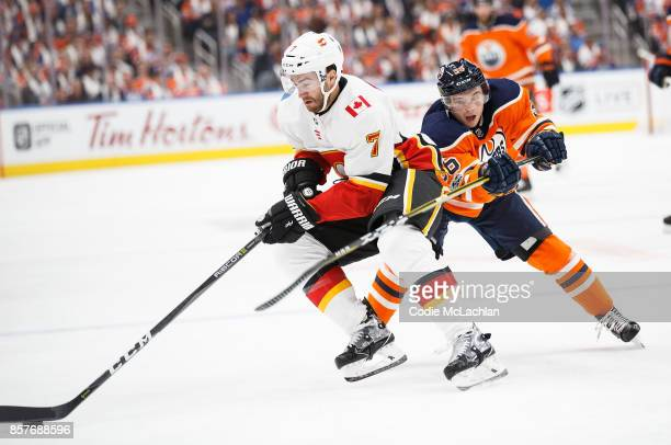 Kailer Yamamoto of the Edmonton Oilers playing in his first NHL game skates against TJ Brodie of the Calgary Flames at Rogers Place on October 4 2017...