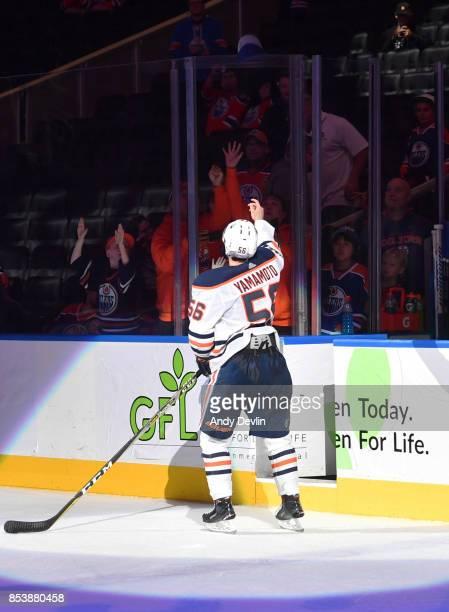 Kailer Yamamoto of the Edmonton Oilers throws a hat to fans following the preseason game against the Carolina Hurricanes on September 25 2017 at...