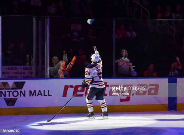 Kailer Yamamoto of the Edmonton Oilers throws a hat to the fans after being selected as the first star following the preseason game against the...