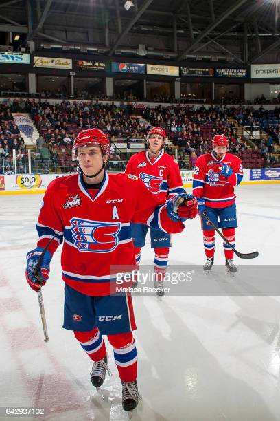 Kailer Yamamoto of the Spokane Chiefs skates to the bench to celebrate a goal against the Kelowna Rockets on February 17 2017 at Prospera Place in...