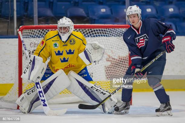 Kailer Yamamoto of the USA sets up next to Filip Larsson of Sweden during a World Jr Summer Showcase game at USA Hockey Arena on August 2 2017 in...
