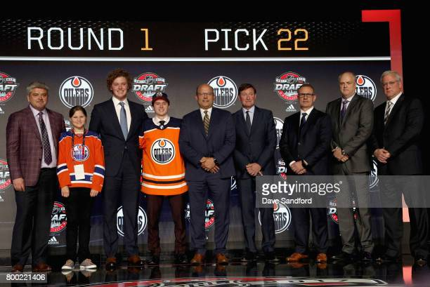 Kailer Yamamoto poses with team personnel onstage after being selected 22nd overall by the Edmonton Oilers during Round One of the 2017 NHL Draft at...