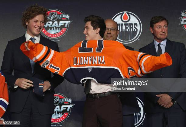 Kailer Yamamoto puts on his jersey after being selected 22nd overall by the Edmonton Oilers during Round One of the 2017 NHL Draft at United Center...