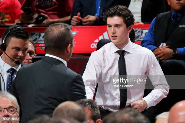 Kailer Yamamoto walks to the stage after being selected 22nd overall by the Edmonton Oilers during the 2017 NHL Draft at the United Center on June 23...