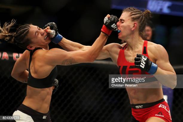 Kailin Curran and Alexandra Albu of Russia trade punches in their women's strawweight bout during the UFC 214 event at Honda Center on July 29 2017...