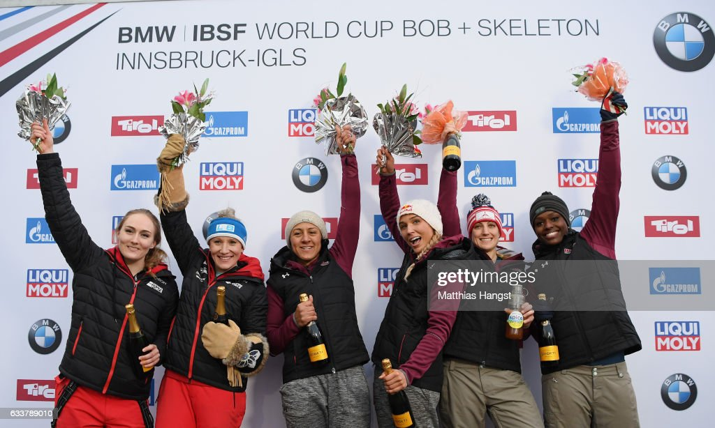 Kaillie Humohries and Melissa Lotholz of Canada, Elana Meyers Taylor and Lolo Jones of the United States and Jamie Greubel Poser and Aja Evans of the United States celebrate after the Women's Bobsleight final run of the BMW IBSF World Cup at Olympiabobbahn Igls on February 4, 2017 in Innsbruck, Austria.