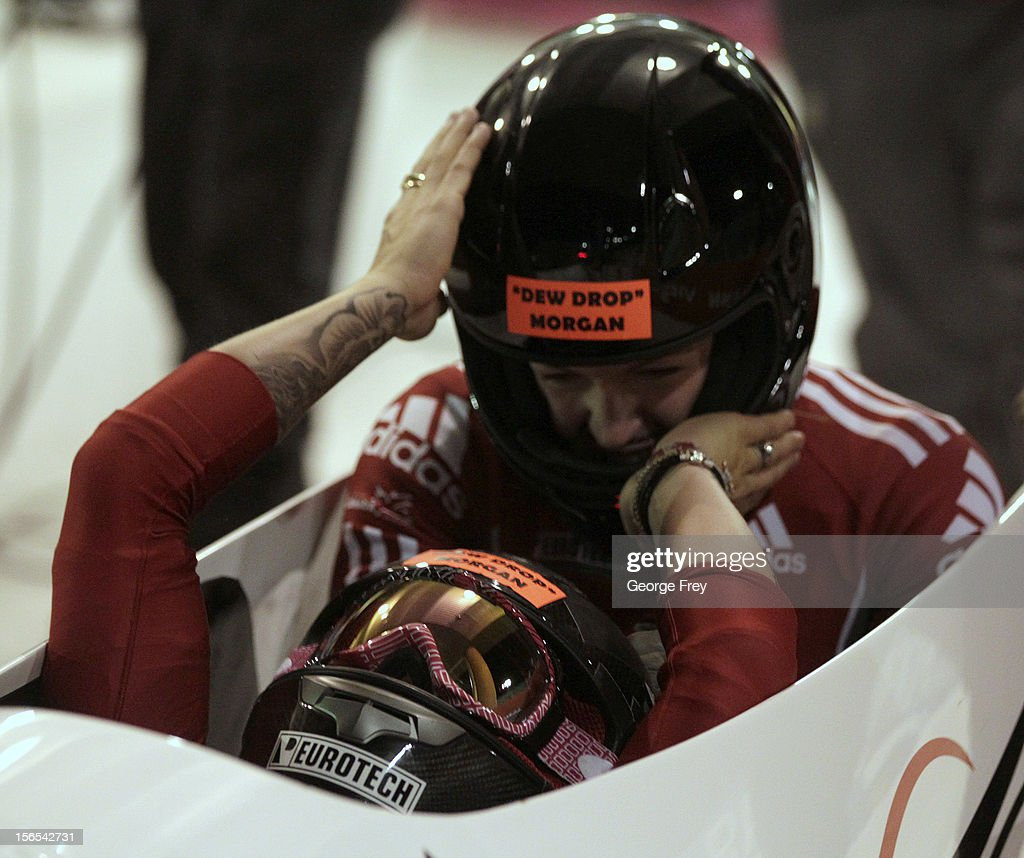 Kaillie Humphries (F) and Chelsea Valios from Canada celebrate their first place finish in the FIBT women's bobsled world cup, on November 16, 2012 at Utah Olympic Park in Park City, Utah.
