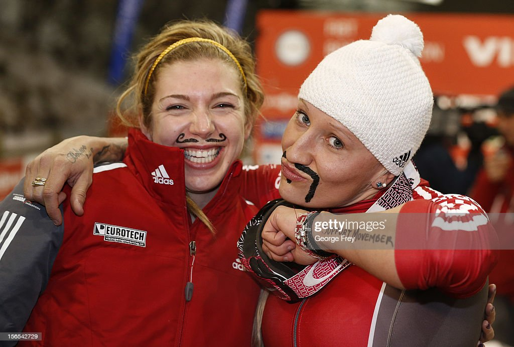 Kaillie Humphries (R) and Chelsea Valios of Canada show off their painted on mustaches after they finished first in the FIBT women's bobsled world cup, on November 16, 2012 at Utah Olympic Park in Park City, Utah.