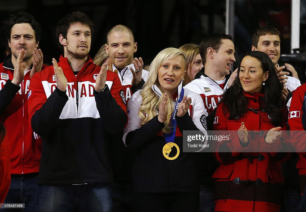 <a gi-track='captionPersonalityLinkClicked' href=/galleries/search?phrase=Kaillie+Humphries&family=editorial&specificpeople=5631265 ng-click='$event.stopPropagation()'>Kaillie Humphries</a>, (C) Canadian Olympic gold medalist in bobsled celebrates with her Olympic teammates before the Calgary Flames played the Los Angeles Kings in their NHL hockey game at the Scotiabank Saddledome February 27, 2014 in Calgary, Alberta, Canada.