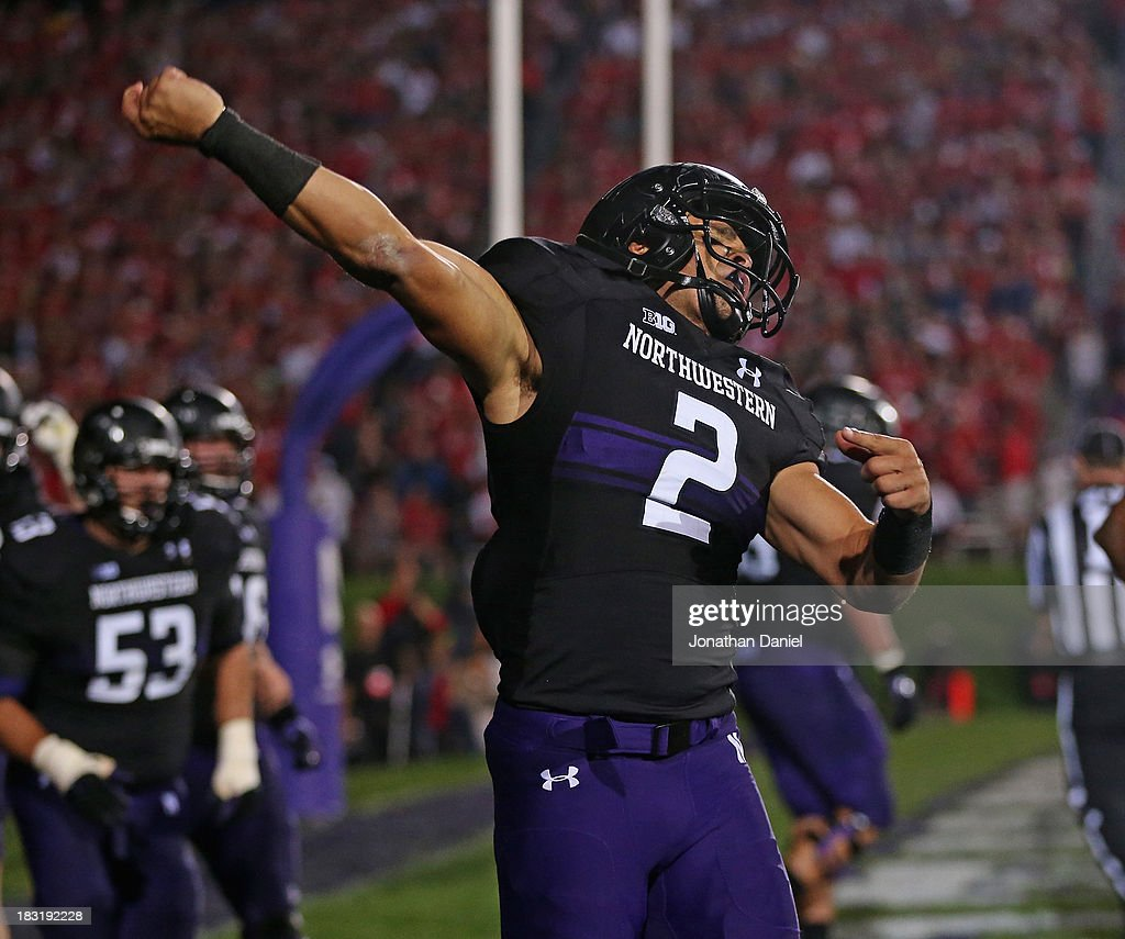Kain Colter #2 of the Northwestern Wildcats celebrates a touchdown catch against the Ohio State Buckeyes at Ryan Field on October 5, 2013 in Evanston, Illinois.