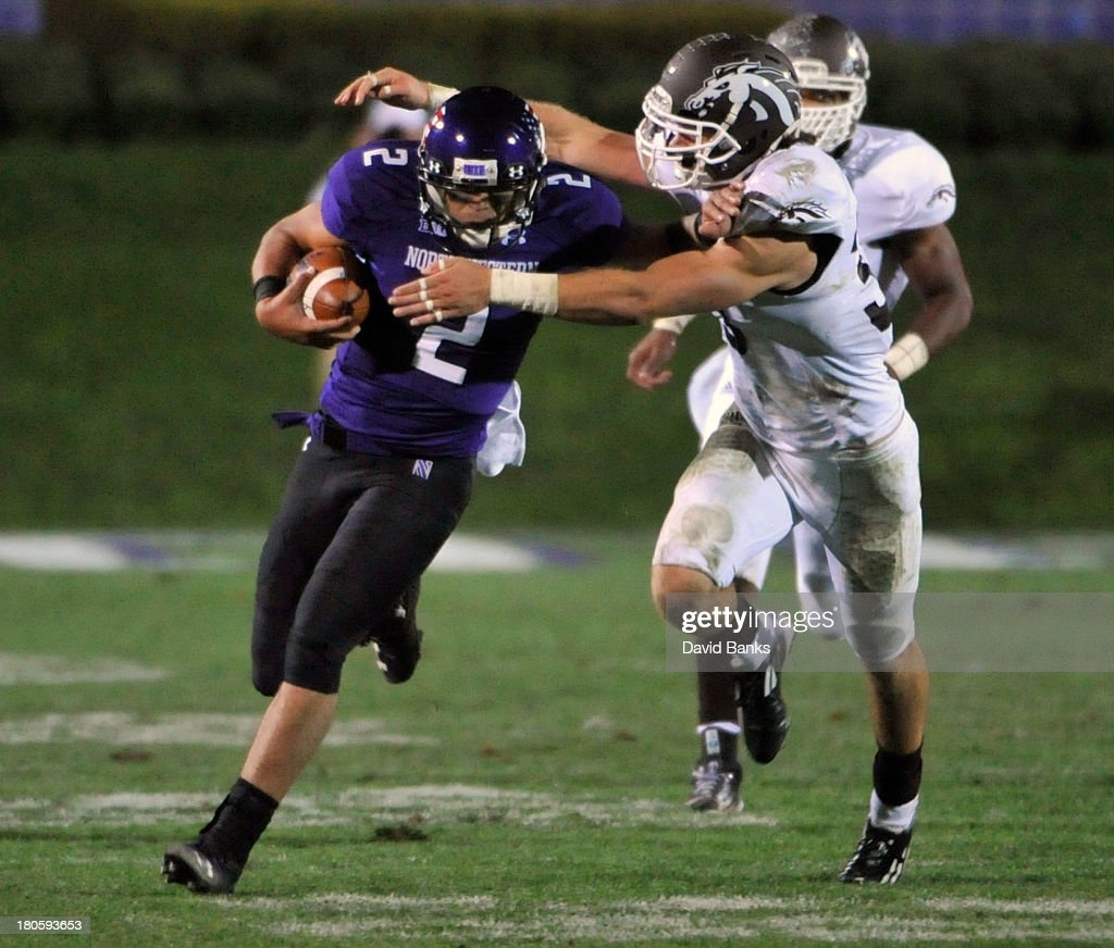 Kain Colter #2 of the Northwestern Wildcats is tackled by <a gi-track='captionPersonalityLinkClicked' href=/galleries/search?phrase=Justin+Currie&family=editorial&specificpeople=5750042 ng-click='$event.stopPropagation()'>Justin Currie</a> #33 of the Western Michigan Broncos during the fourth quarter on September 14, 2013 at Ryan Field in Evanston, Illinois. The Northwestern Wildcats defeated the Western Michigan Broncos 38-17.