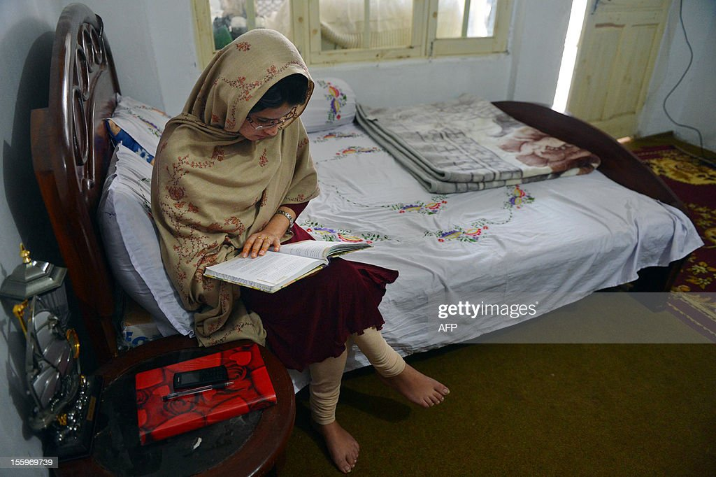 Kainaat Riaz, 16, a school friend of Pakistan's child activist Malala Yousafzai, studies at her residence in Mingora in Pakistan's northwestern Swat Valley on November 10, 2012. One of the schoolgirls wounded in a Taliban murder attempt on teenage Pakistani activist Malala Yousafzai said on November 10 she was still haunted by the memory of the bloody attack. Kainaat Riaz, 16, suffered a hand injury when Islamist gunmen attacked her school bus in a bid to kill Malala for the 'crime' of promoting girls' education.