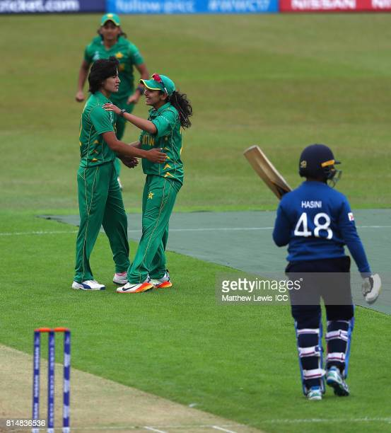 Kainat Imtiaz of Pakistan congratulates Diana Baig on the wicket of Hasini Perera of Sri Lanka after she was caught by Sidra Nawaz during the ICC...