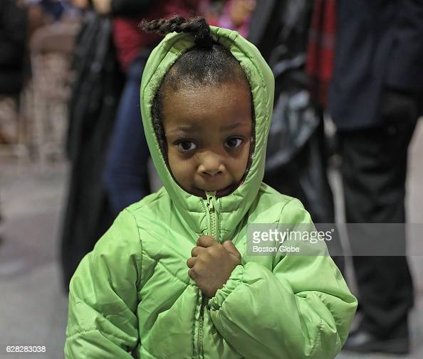 Kaira Payne is pictured with her new coat after shopping with her grandmother Maghony Payne of Boston's Mattapan neighborhood at The Massachusetts...