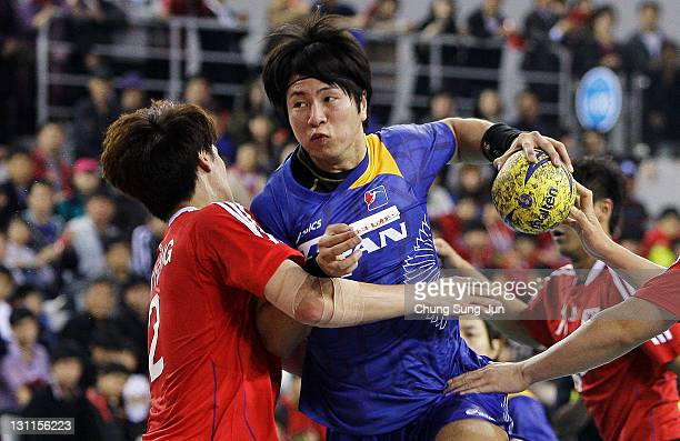 Kairi Kochi of Japan throws a goal during the London Olympic Men's Handball Asian Qualifier Final match between Japan and South Korea at the Olympic...
